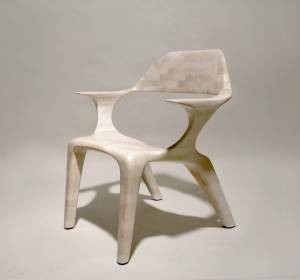 Picture of a lounge chair made from bleached cherry wood, seen in three-quarter view