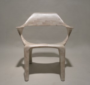 This is a photo of a hand-sculpted, bleached cherry lounge chair seen from the front