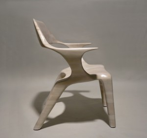 Profile view of a lounge chair made of bleached cherry, sculpted by hand