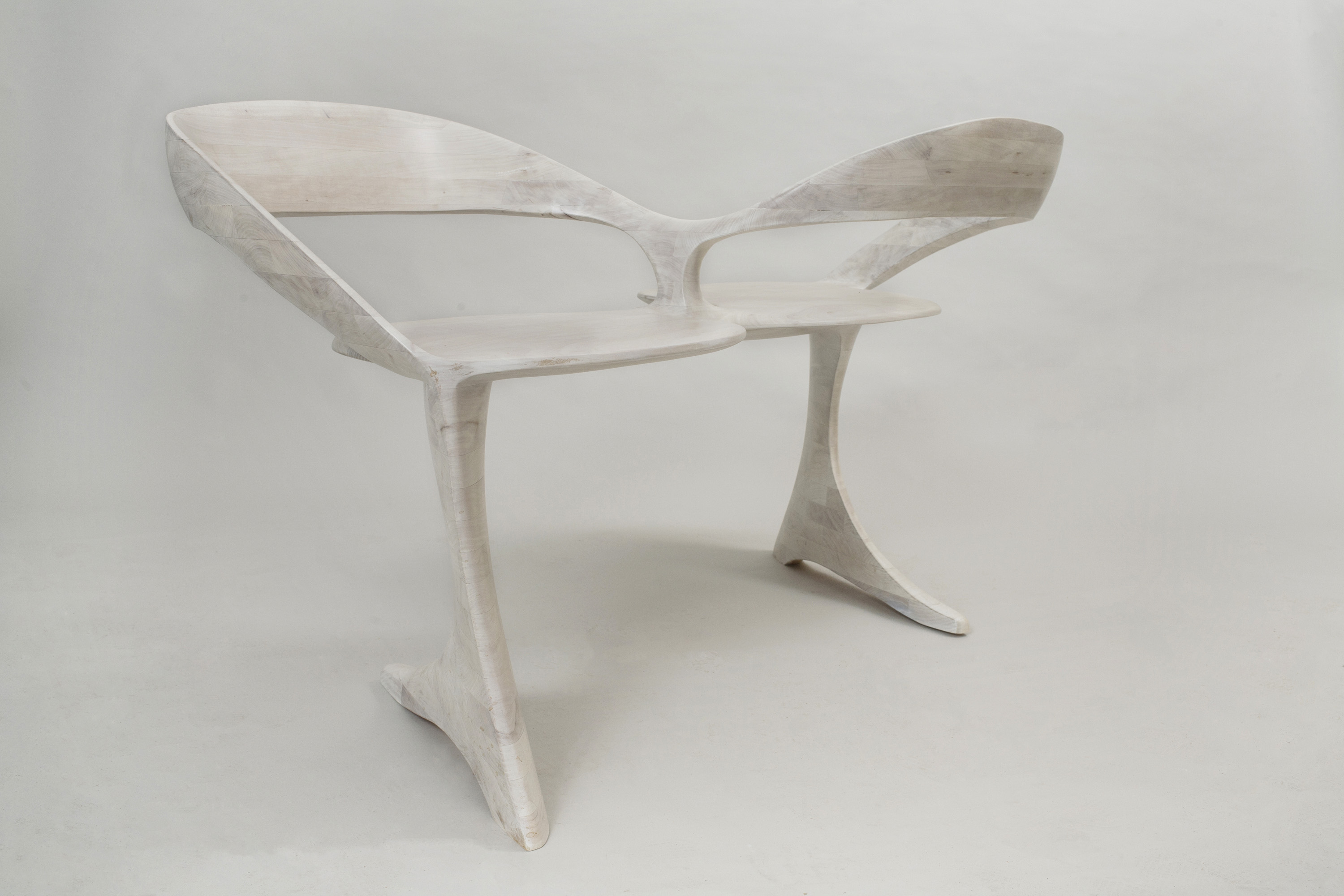 This picture shows a loveseat made of bleached cherry seen from three-quarters view