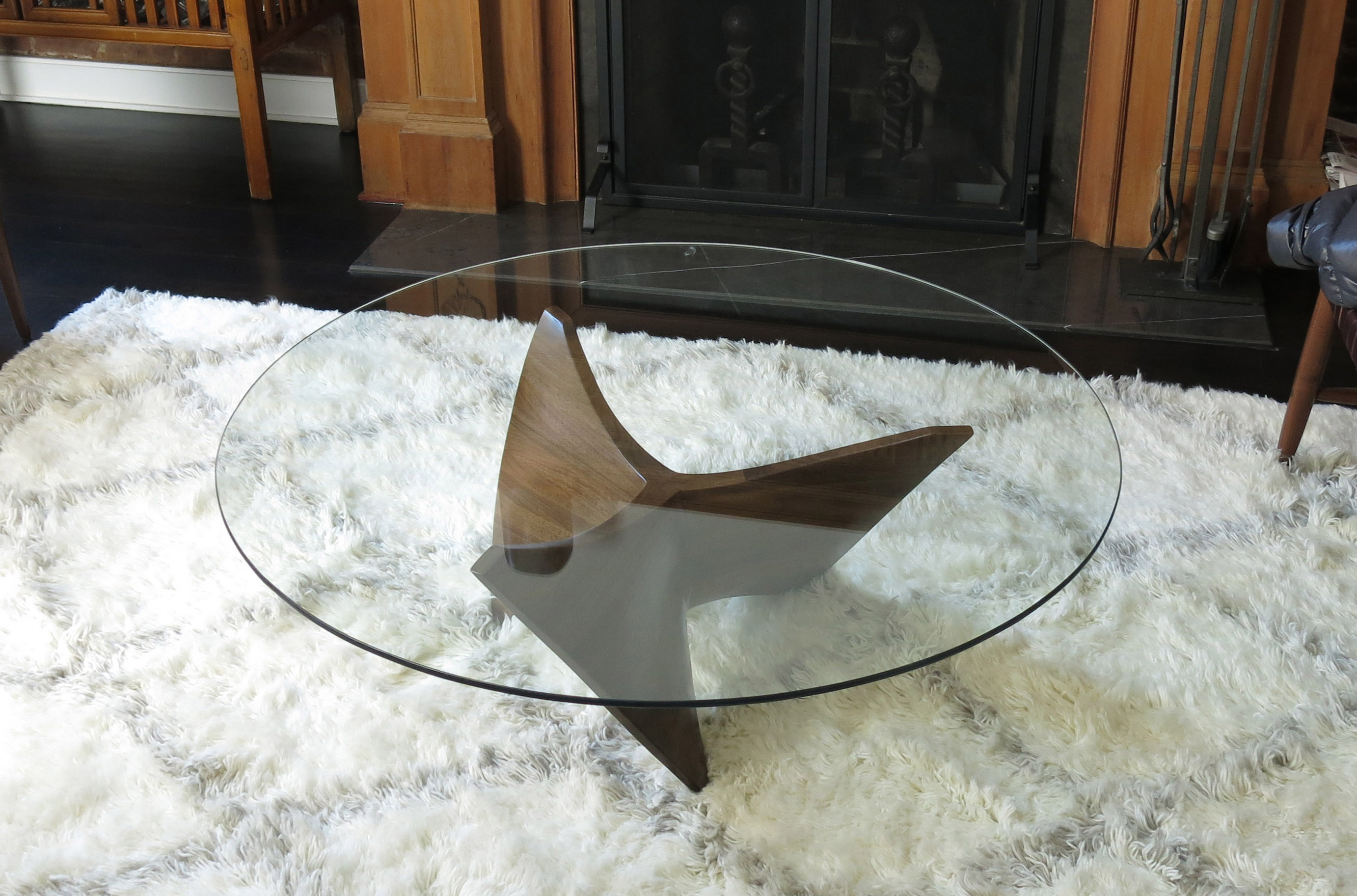 This is a photo of a sculpted wood coffee table installed