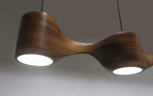 Close up view of a hand-sculpted pendant lamp made from oak