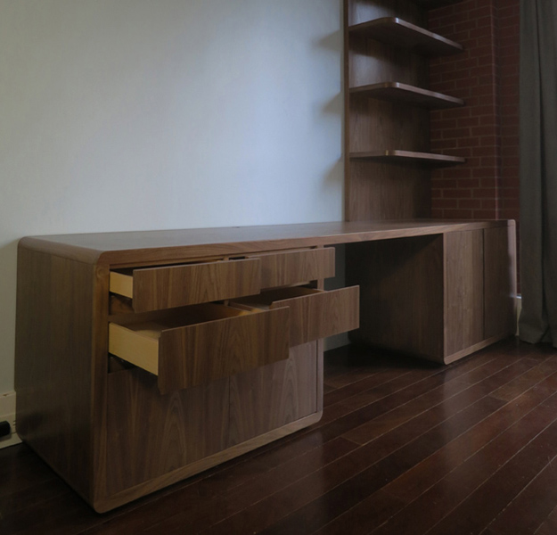 walnut desk and shelves