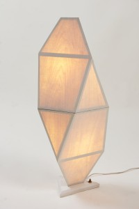 Veneered geometric lamp fully lit