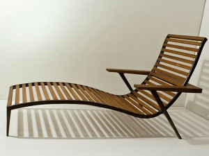 teak and bronze lounge chair