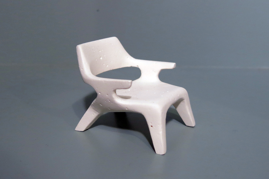 This is a scaled plaster model of a lounge chair