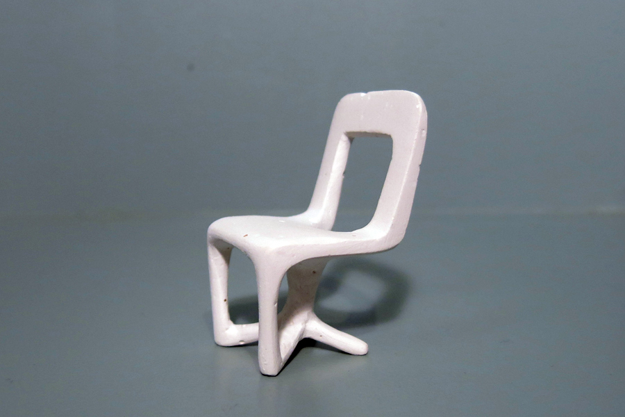 Miniature plaster version of a chair