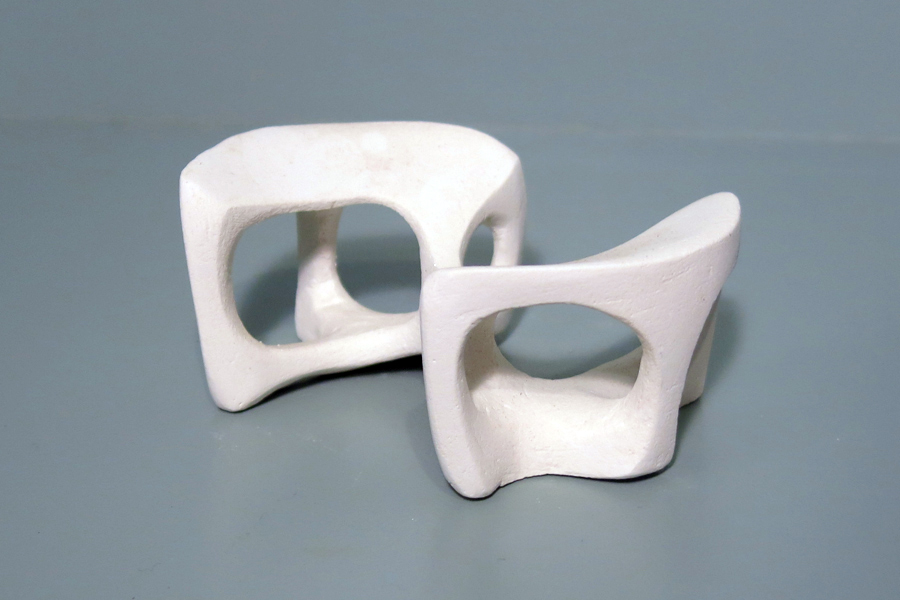This image shows a miniature plaster version of a table base