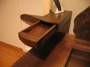 sculpted walnut bedside table