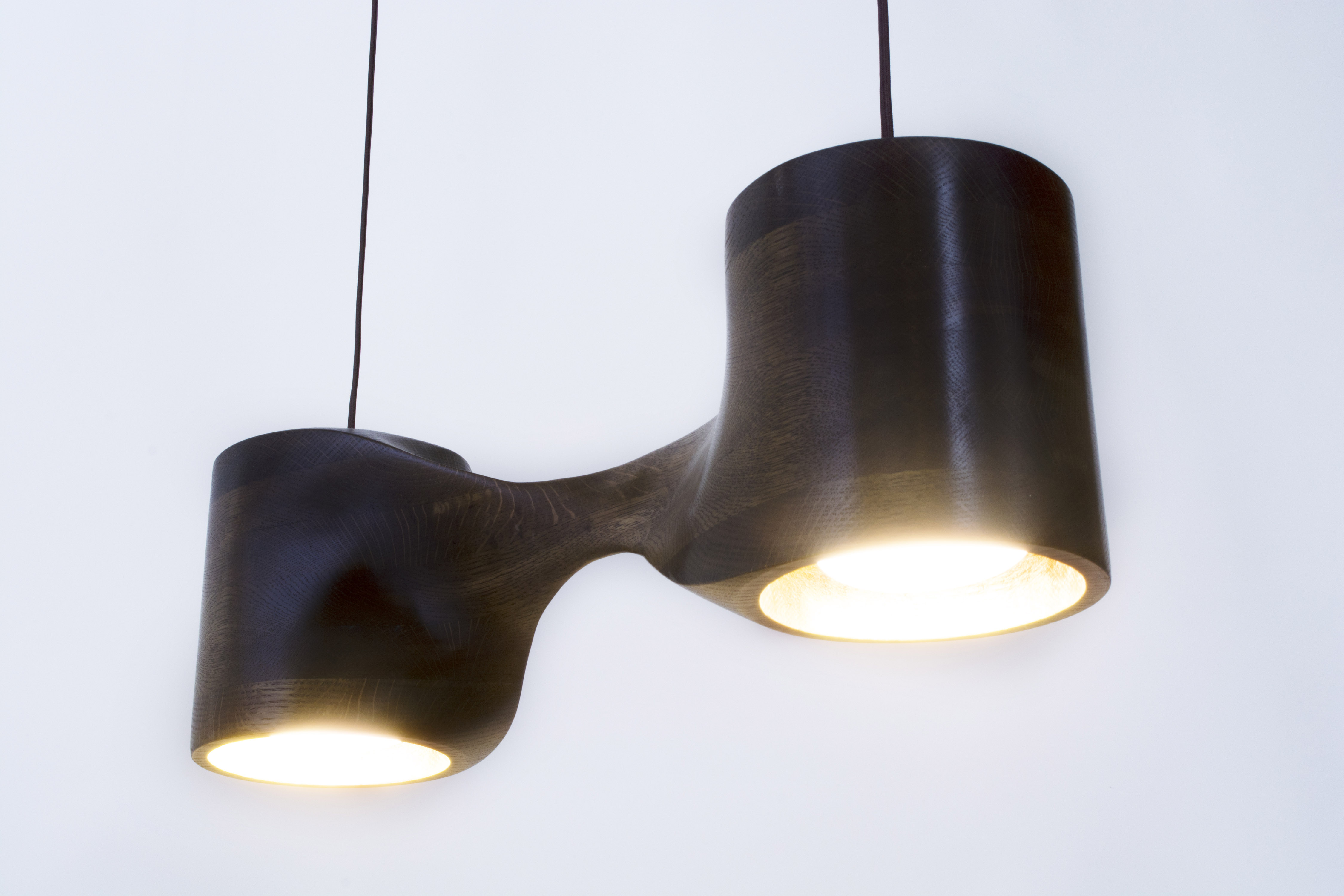 scupted wood pendant lamp with gold leafing