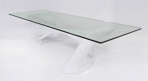 sculpted, white lacquered dining table with glass top