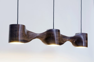 sculpted wood pendant lamp with gold leaf